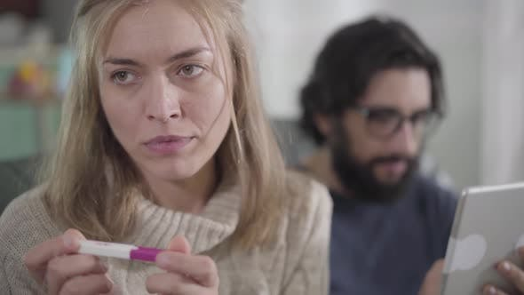 Thumbnail for Close-up Portrait of Feared Caucasian Woman Looking at Affirmative Pregnancy Test As Her Husband
