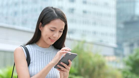 Thumbnail for Woman using smart phone at outdoor