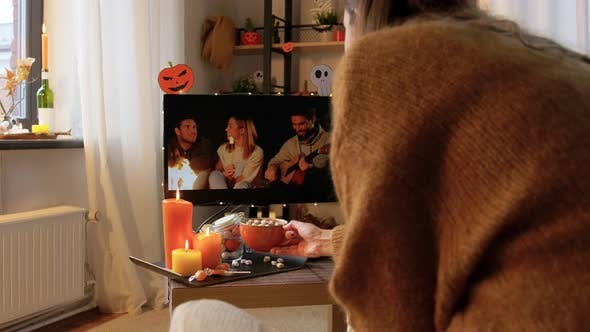 Thumbnail for Woman Watches Tv and Drinks Cocoa on Halloween