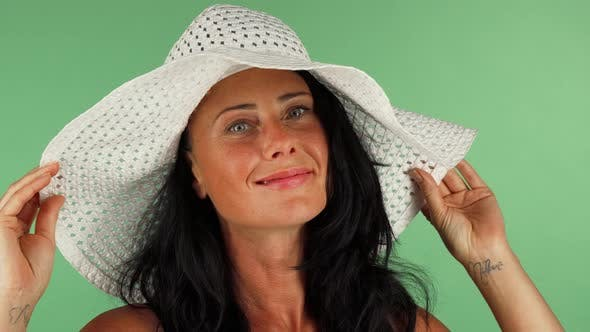 Thumbnail for Attractive Woman Smiling To the Camera Wearing White Hat