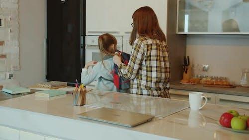 Adorable Child Little Girl Leaving Home for School Hugging Mother Saying Good-bye