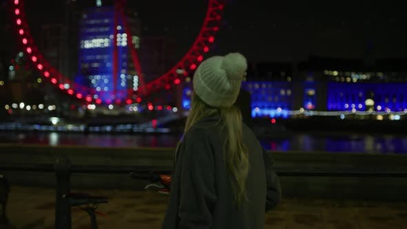 Thumbnail for Happy Girl Walking and Admiring the London Eye, at Night