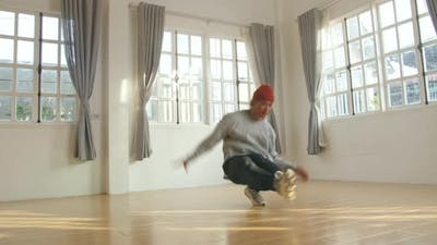 Male Break Dancer Dancing In Home