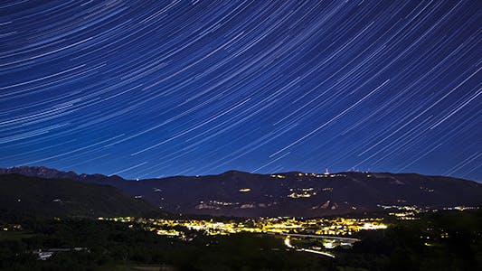 Thumbnail for Star Trails Above Mountains