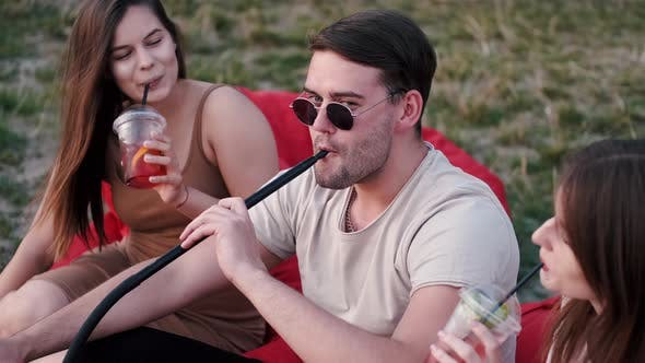 Thumbnail for The Young Man Smoking Hookah and Ladies Are Having Fun
