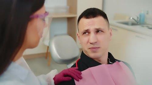 Female Dentist Communicates with Patient