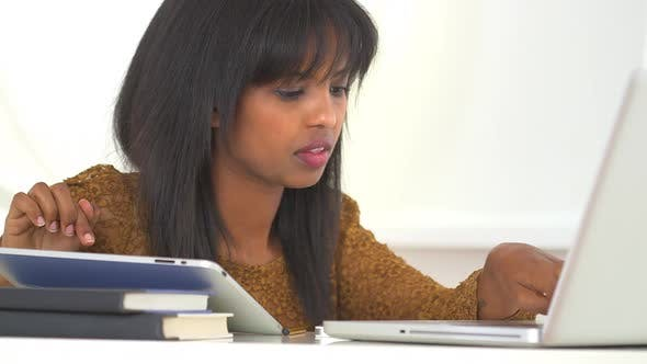 Thumbnail for Black college student studying with new technology