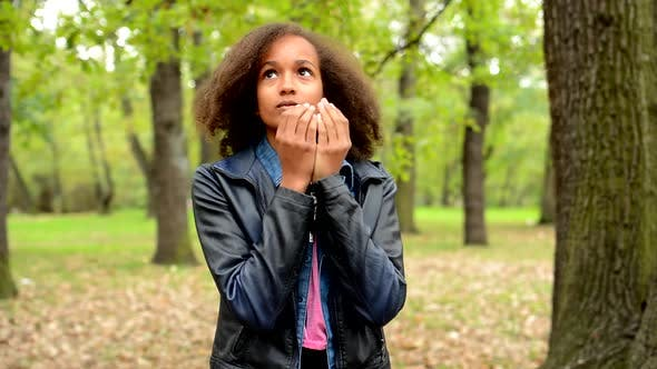 Thumbnail for Young African Frightened Girl Is Appear in Unknown Place in the Park - She Observe the Surroundings
