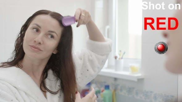 Thumbnail for Woman Brushing Hair