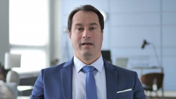 Thumbnail for Portrait of Businessman Celebrating Success