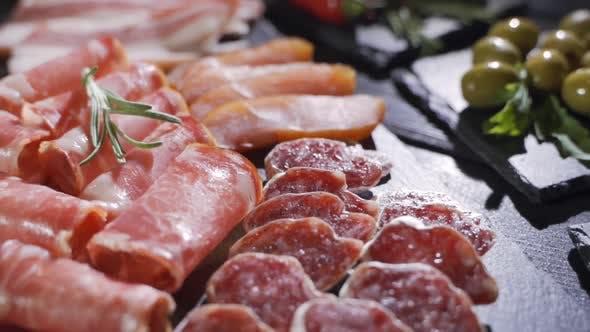 Salami and Chorizo Sausage Close Up on Dark Concrete Background