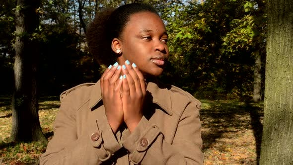 Thumbnail for Young Happy African Girl Stands in Woods, Takes Hands Off From Face, Looks Around and Is Surprised