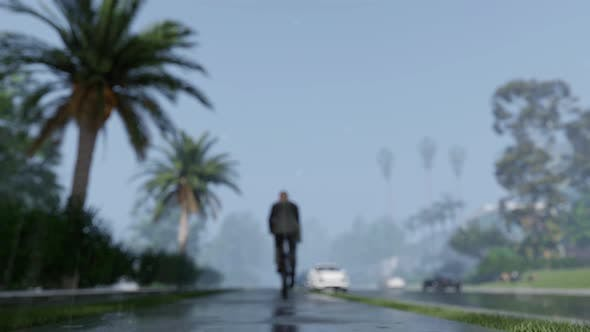 Thumbnail for Man On Bicycle Rides Under The Rain