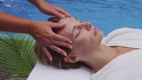 Woman at spa gets facialmassage. Shot on RED EPIC for high quality 4K, UHD, Ultra HD resolution.