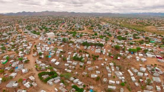 Thumbnail for A Bird's-eye View Taken Over a City with Ruined Houses in Namibia, Africa