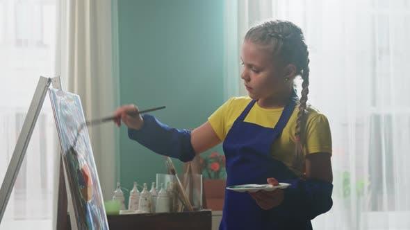 Little Girl Artist Is Looking On Camera