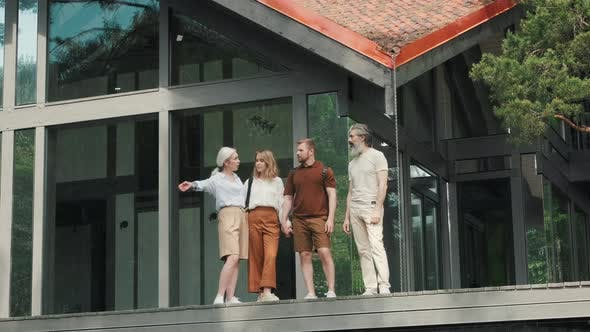 Thumbnail for Senior People and Young Couple Standing on Porch of Modern House