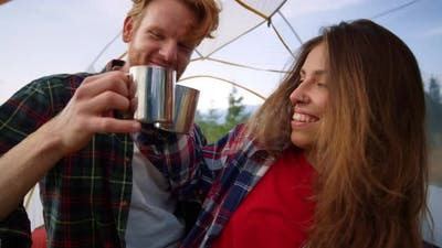Couple Sitting in Tent Together