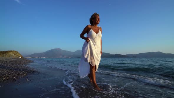 Cover Image for Female Walking on Sunny Beach