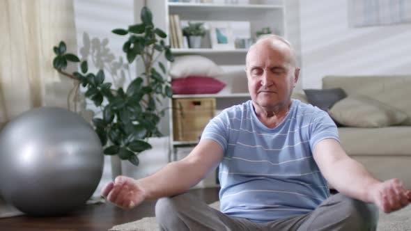 Thumbnail for Senior Man Meditating in Lotus Pose