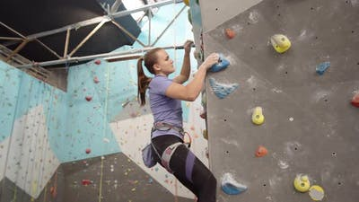 Female Climber Practicing Bouldering