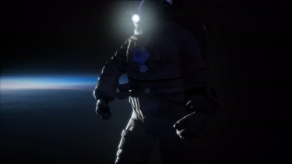 Thumbnail for Astronaut in Outer Space Against the Backdrop of the Planet Earth