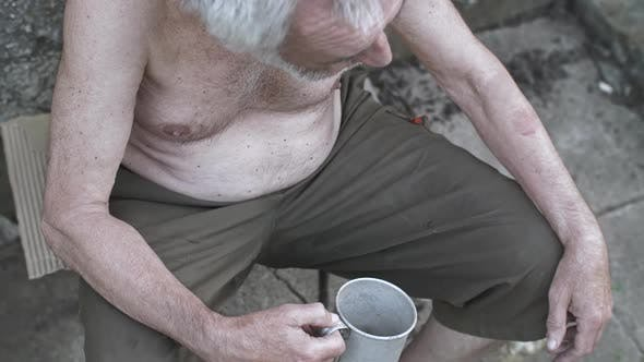Thumbnail for Homeless Man with a Cup Asking for Donation
