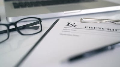 Rx Prescription On Doctor Desk