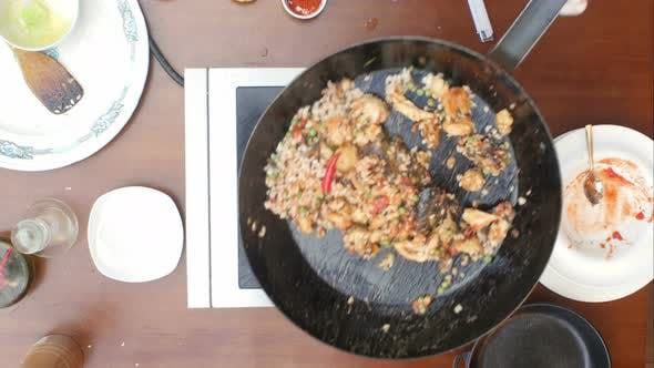 Thumbnail for Mixing Paella and Seafood in a Pan, Cooking