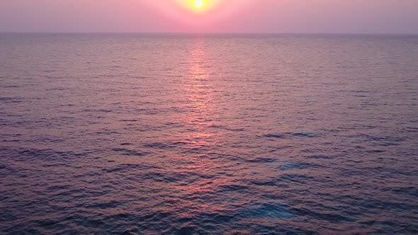 Daytime travel of luxury coastline beach voyage by blue sea and bright sandy background near resort