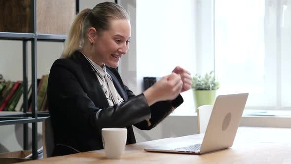 Cover Image for Celebrating Success, Woman Working on Laptop