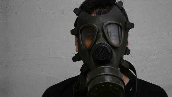 Man Puts On Gas Mask