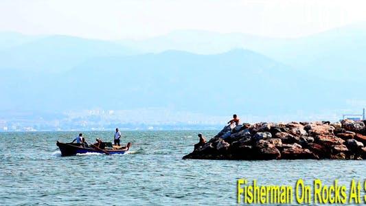 Thumbnail for Fisherman On The Rocks