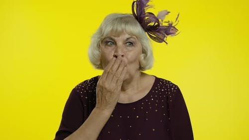 Shocked Frightened Senior Old Woman Covering Mouth with Hand and Looking Terrified at Camera