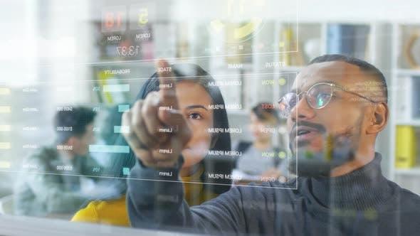 Diverse Colleagues Using Futuristic Virtual Screen in Office