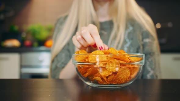 Thumbnail for Glad Woman Eating Potato Chips.