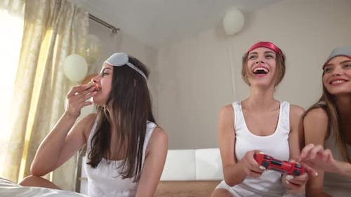 Smiling Women Playing with Video Game with Joystick.