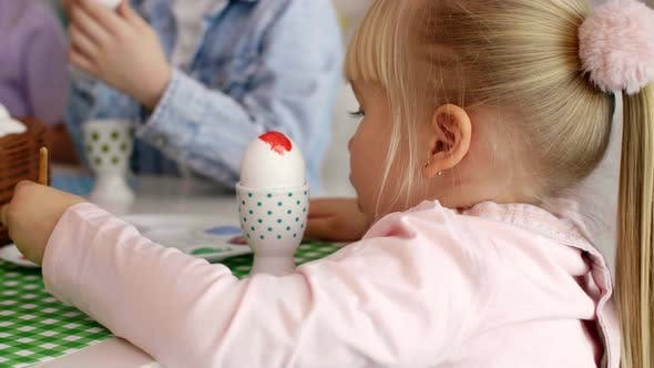 Thumbnail for Close up Of Girl Painting Easter Egg