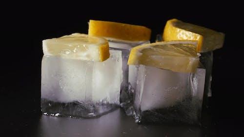 Small Piece of Lemon Lies on an Ice Cube