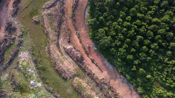 Aerial view following excavator move at land clearing area
