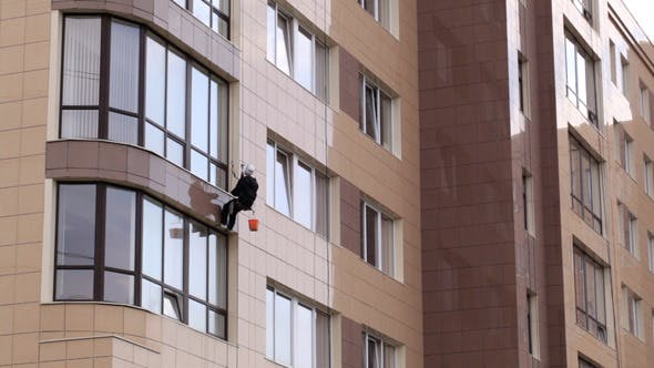 Thumbnail for Man Washes The Windows Of Office Building 1