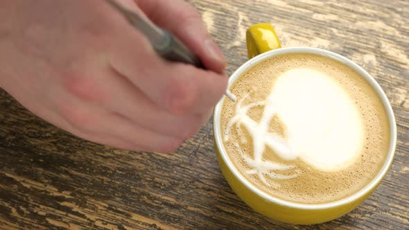 Hand of Barista and Coffee.