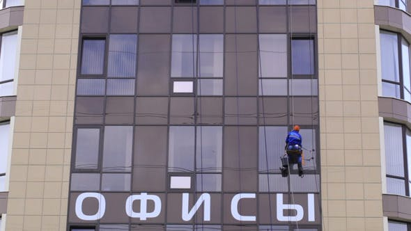 Thumbnail for Man Washes The Windows Of Office Building 2