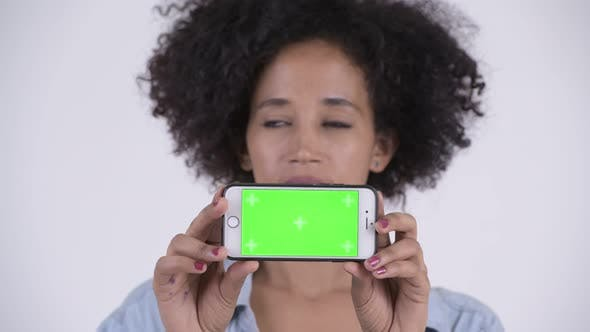 Thumbnail for Face of Young Happy African Woman Thinking While Showing Phone