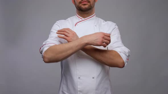 Happy Smiling Male Chef in Toque and Jacket