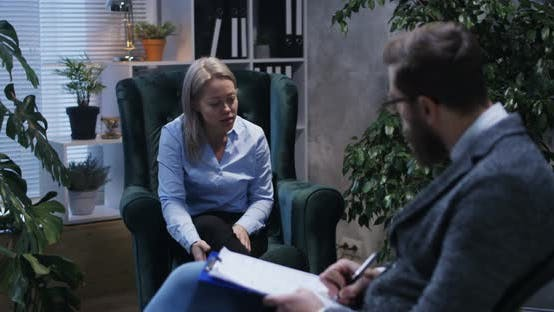 Thumbnail for Young Woman Talking To Psychologist
