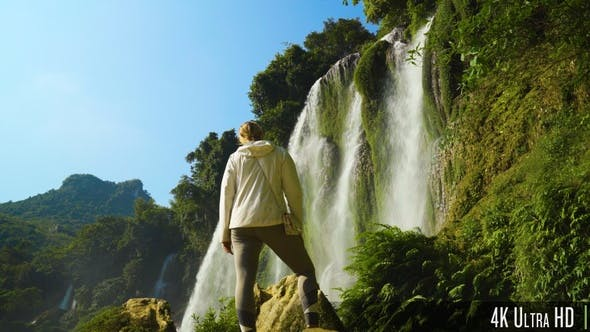 Thumbnail for 4K Back of Young Woman in Front of Waterfall in the Mountains of Vietnam