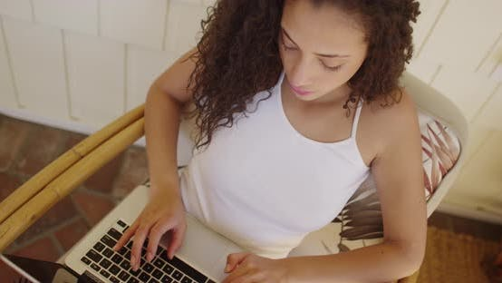 Thumbnail for A beautiful young hispanic woman communicating on her laptop computer online