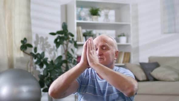 Thumbnail for Elderly Man Meditating in Lotus Pose at Home