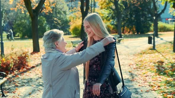 Thumbnail for Grandmother and Granddaughter Hugging Each Other in Park